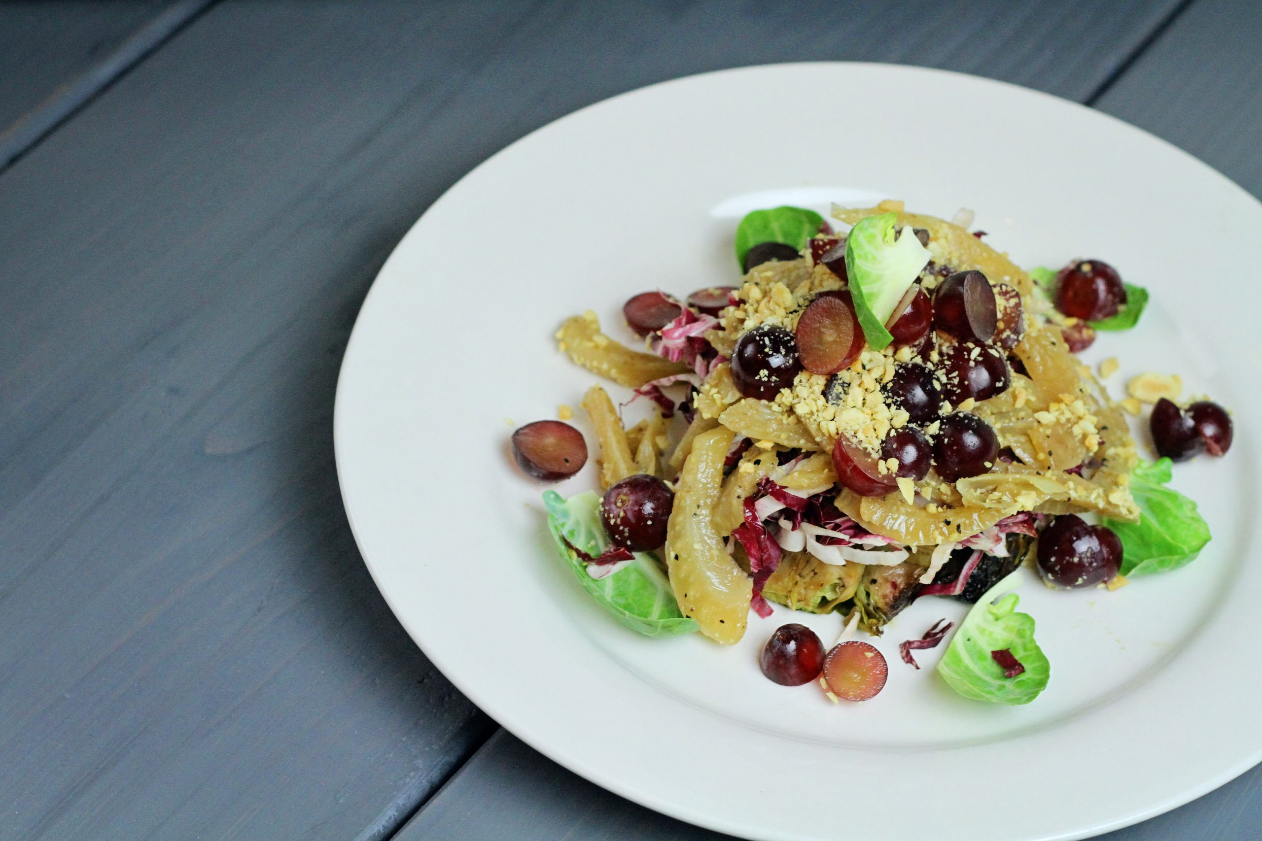 Roasted Brussel Sprout Salad with Caramelized Fennel, Marcona Almonds, and fresh Red Grapes – Vegan Paleo Foods for Spring by Chef Jesa Henneberry